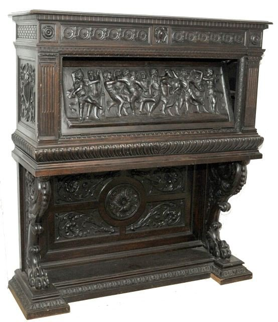 7: A Spanish Rococo Revival Carved and Stained Oak Varg