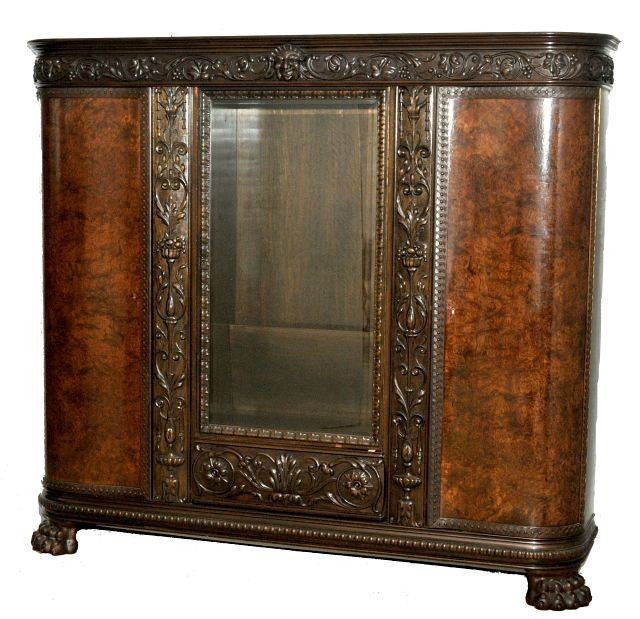 17: A Continental Rococo Revival Carved Oak with Walnut