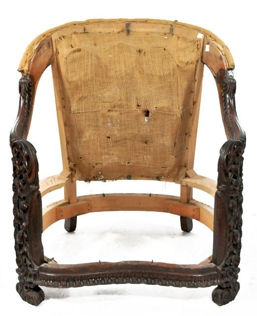 23: A Rococo Revival Carved and Stained Hardwood Chair