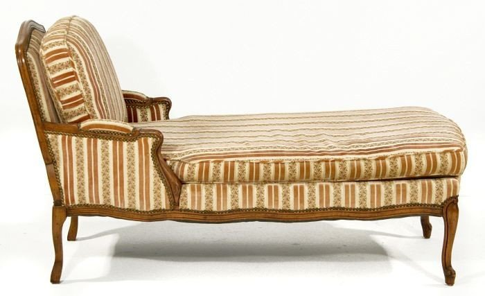 9: A French Provincial Style Stained Hardwood Chaise Lo
