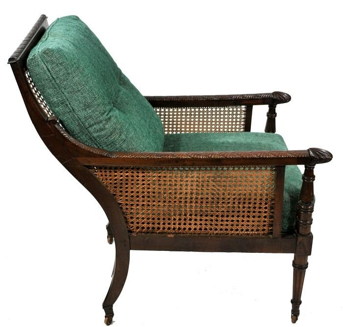 11: A Regency Style Carved Mahogany Armchair, with cane