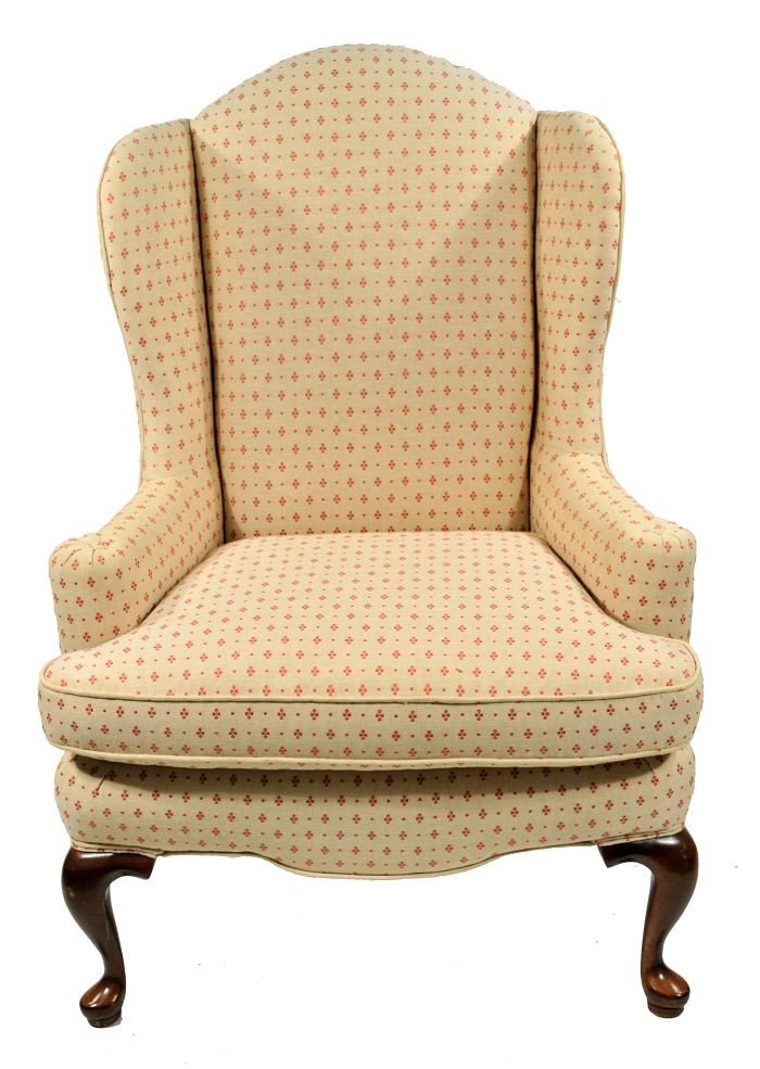 15: A Queen Anne Style Wing Back Armchair, 20th Century