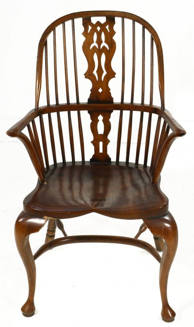 21: A Windsor Style Sack-back Oak Armchair, 20th Centur