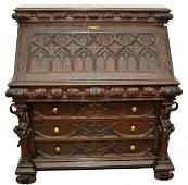 232: A Gothic Revival Carved Oak Slant Front Desk in th