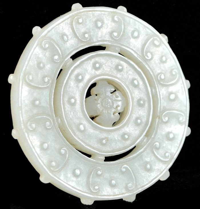 255: A Chinese White Jade Bi-disc with Prayer Wheel,