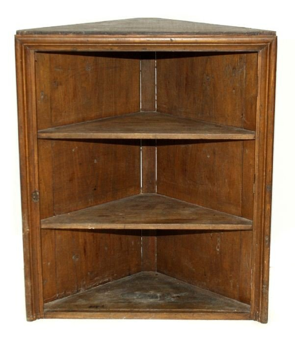 310: An American Pine Corner Cupboard, 19th Century.