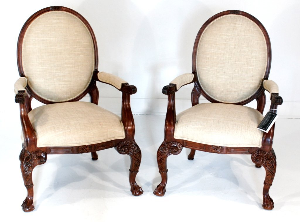 1: A Pair of Oscar De La Renta Carved Mahogany Open Arm