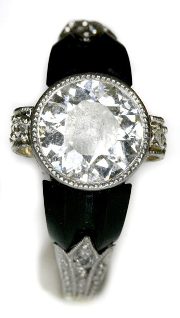 132: An Art Deco 14kt. White Gold Diamond and Onyx Ring