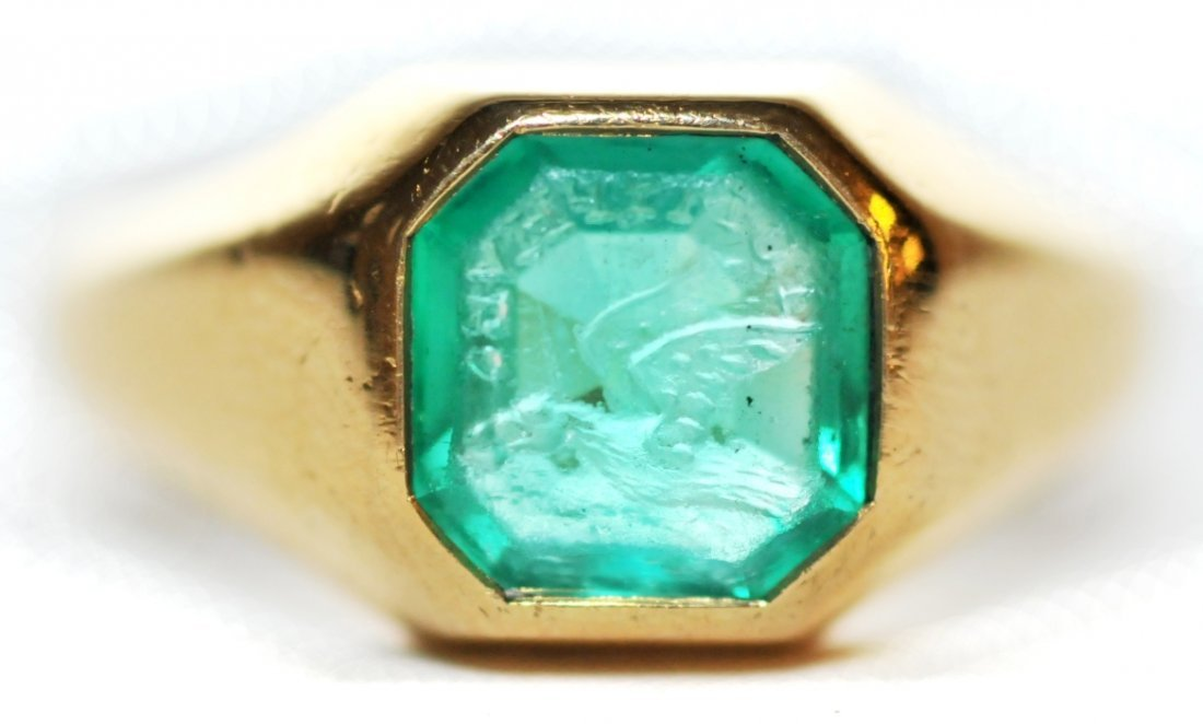 137: An 18kt. Yellow Gold and Engraved Emerald Signet R