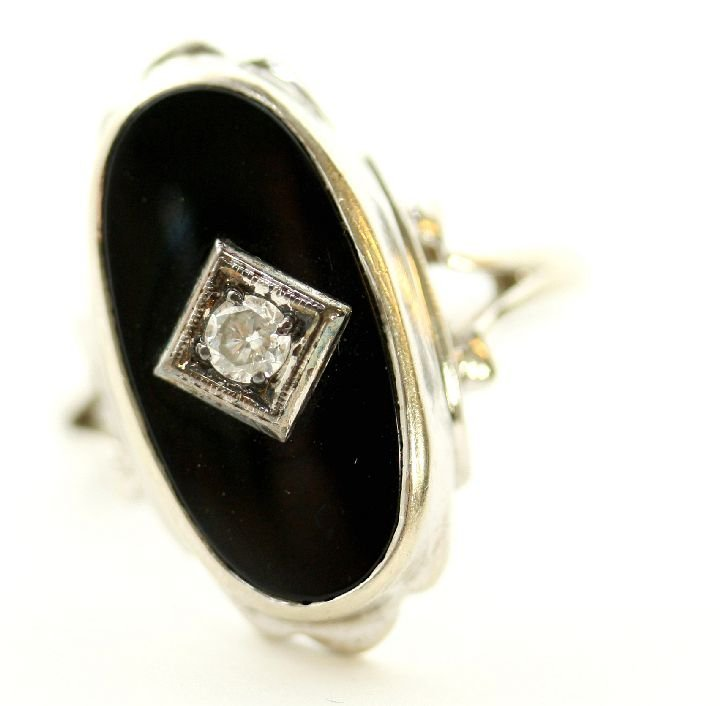139: A 14kt. White Gold Onyx and Diamond Ring,