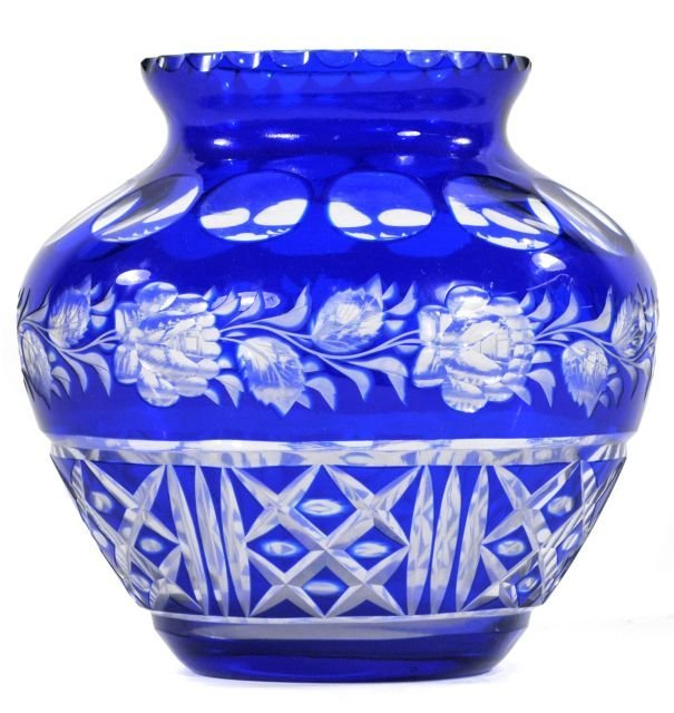 218: A Bohemian Blue Cut to Clear Vase, 20th Century.