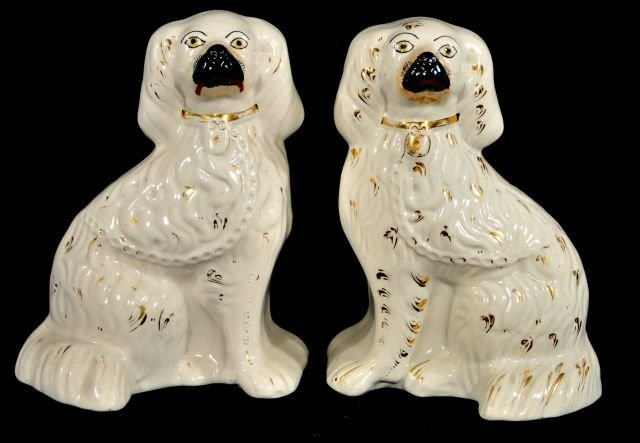 223: A Pair of Staffordshire Spaniels, 19th Century.