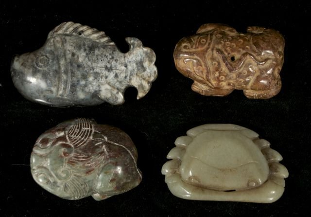 258: A Group of Four Chinese Carved Jade and Hard Stone