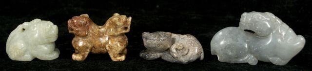 260: A Group of Four Chinese Carved Jade and Hard Stone