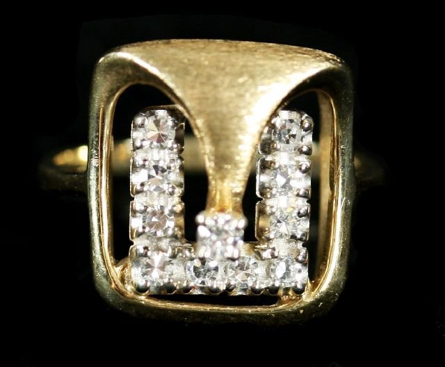 5: A 14kt. Yellow Gold and Diamond Melee Ring.