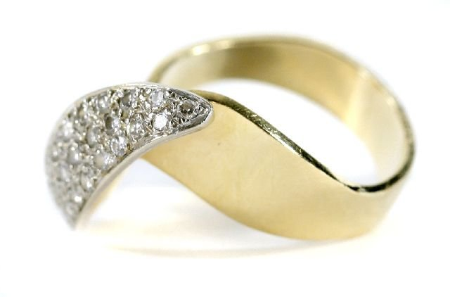 6: A 14kt. Yellow Gold and Diamond Melee Ring.