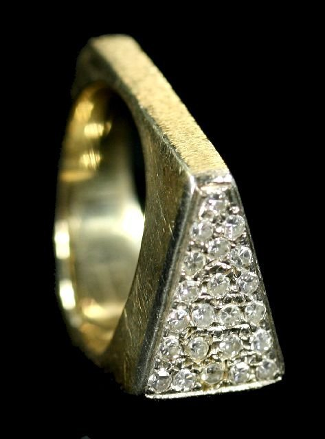 7: A 14kt. Yellow Gold and Diamond Melee Ring.