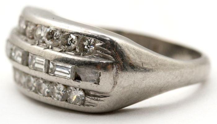 9: A Ladies Platinum and Diamond Ring,