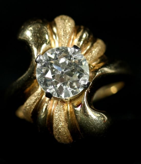 12: A 14kt. Yellow Gold and Diamond Ring,