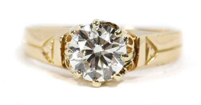 13: A 14kt. Yellow Gold and Diamond Ring,