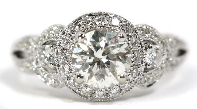 16: An 18kt. White Gold and Diamond Ring,
