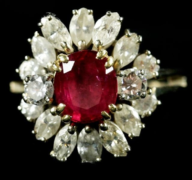 17: An 18kt. White Gold Diamond and Ruby Ring,