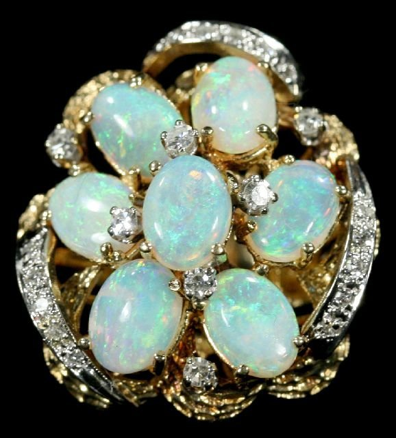 21: A 14kt. Yellow Gold Diamond and Opal Ring,
