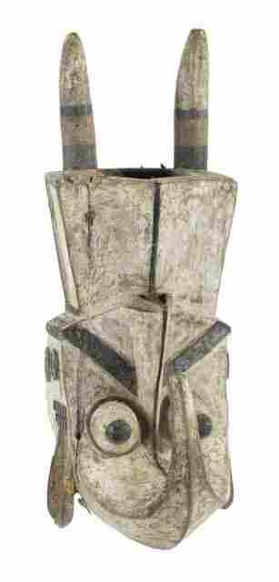 An African Carved Hardwood Polychrome Headdress, Igbo (