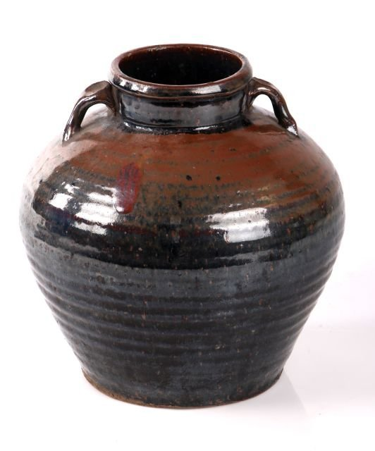 A Chinese Earthenware Storage Vessel.