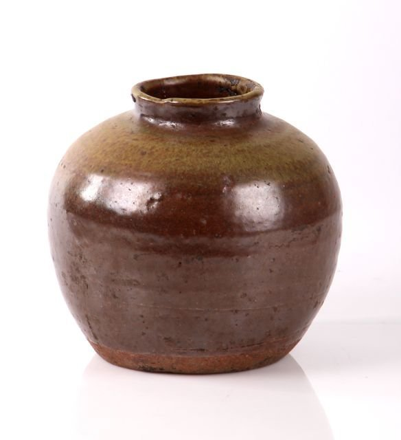 A Chinese Glazed Earthenware Food Storage Jar.
