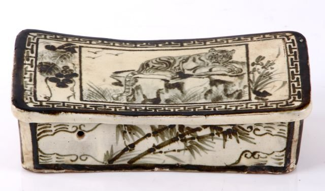 A Chinese Earthenware Pillow, 20th Century.