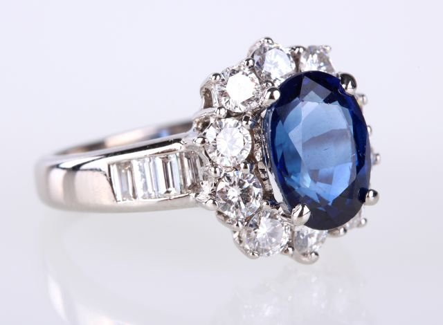 An 18kt. White Gold, Blue Sapphire and Diamond Ring,