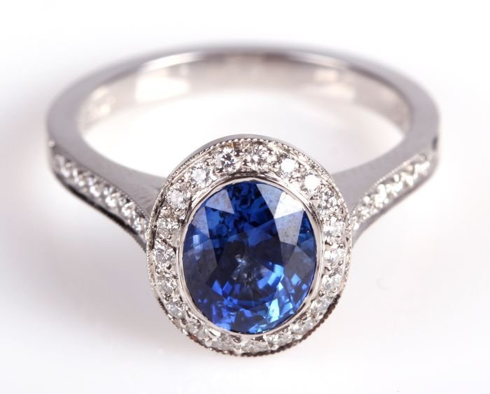 An 18kt. White Gold, Natural Blue Sapphire and Diamond