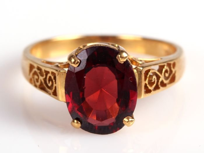 An 18kt. Yellow Gold and Red Spinel Ring,
