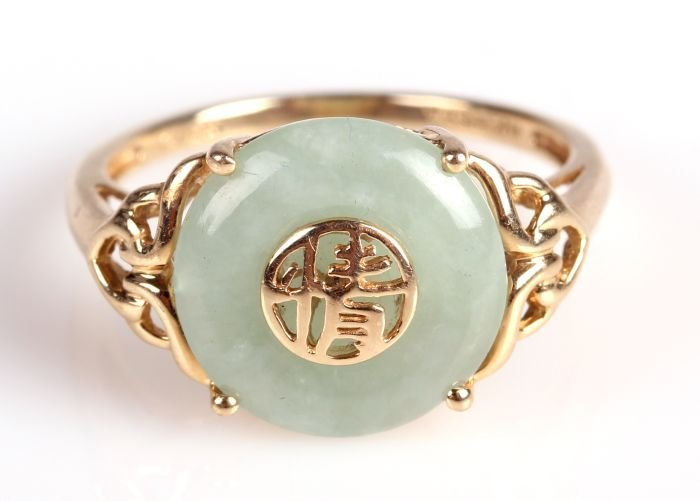 A 14kt. Yellow Gold and Jade Ring.