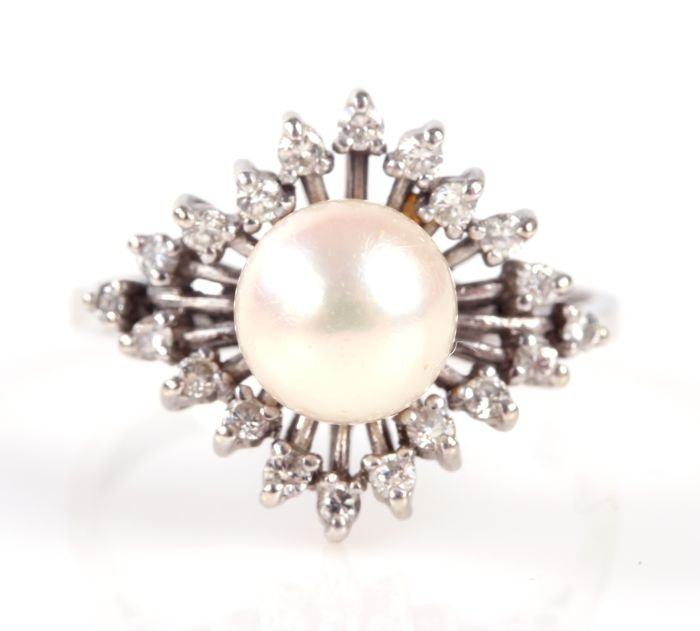 An 18kt. White Gold, Pearl and Diamond Melee Ring.
