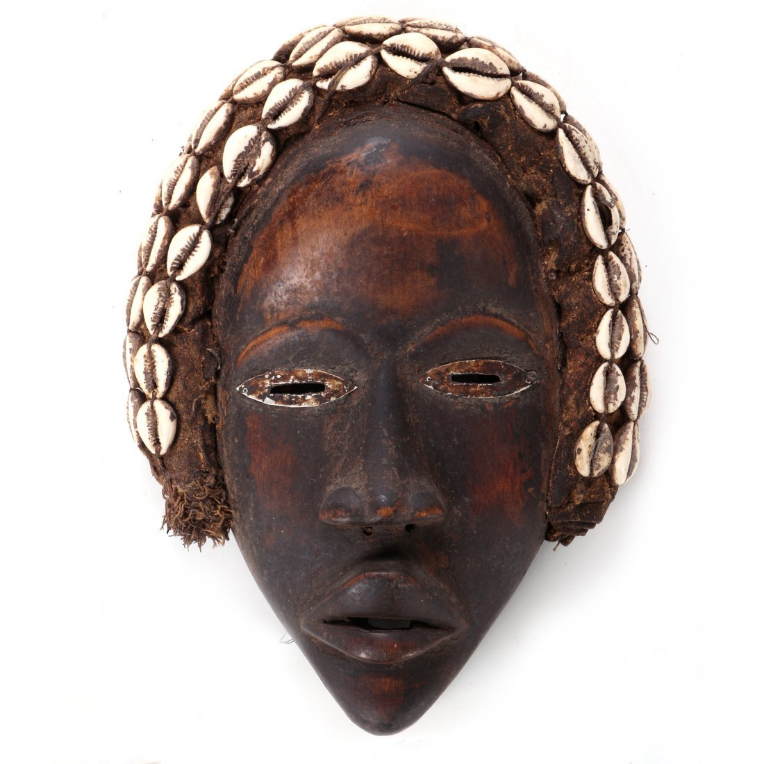 A Dan Tribe Carved Wood and Cowrie Shell Mask, 20th
