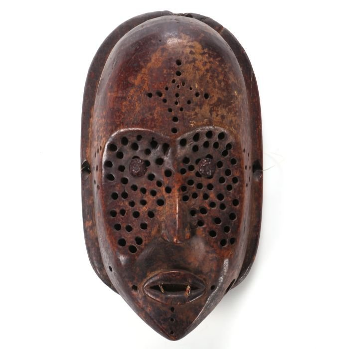 A Carved and Perforated Wood Lulua Mask, Congo, 20th