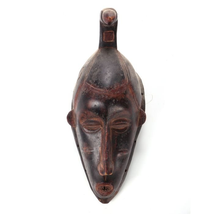 A Guro Tribe Carved and Painted Wood Mask, Ivory Coast,