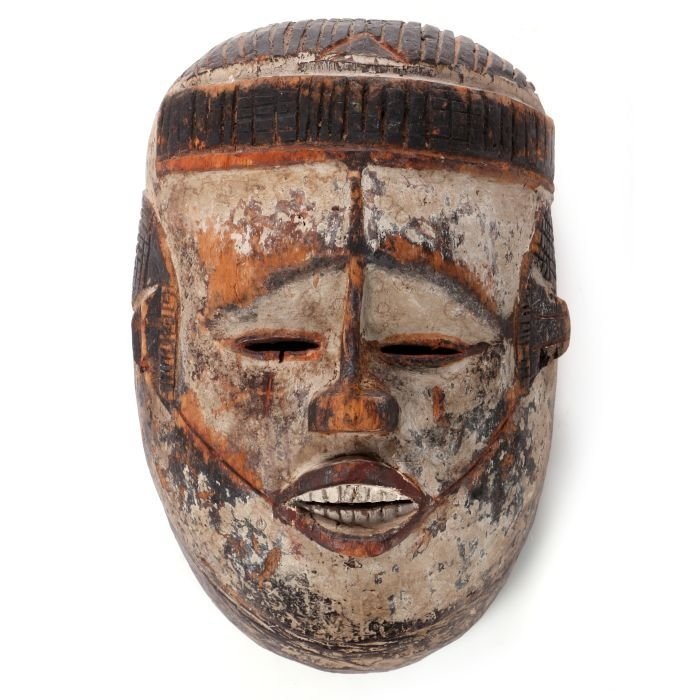 A Yoruba Tribe Carved and Painted Wood Mask, 20th
