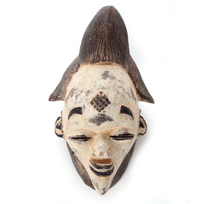 A Punu Tribe Carved and Painted Wood Mask, Gabon, 20th