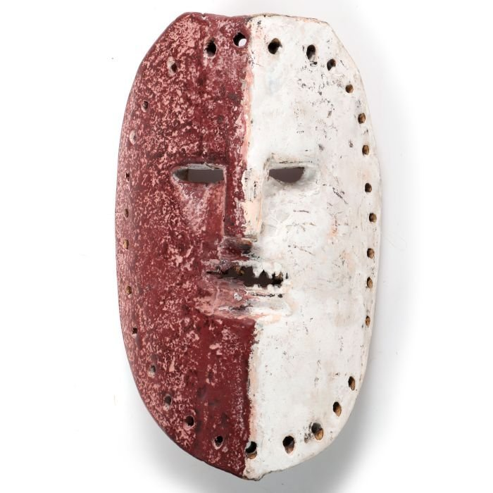 An African Carved and Painted Wood Mask, 20th Century.