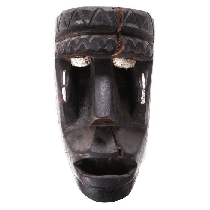 An African Carved and Painted Wood Mask, Possibly