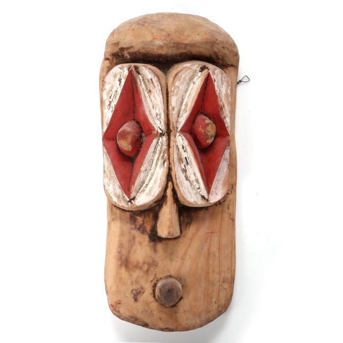 An African Carved and Painted Wood Mask In the Style of