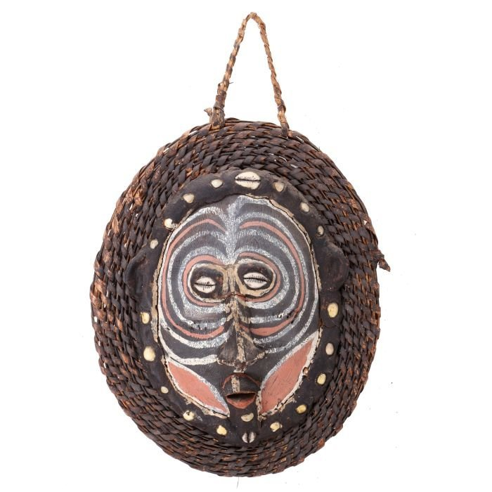 A Sepik Tribe Carved and Painted Shell Mask, Papua New