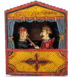 A Cast Iron Punch and Judy Mechanical Bank Manufactured