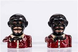 A Pair of Cast Iron Jolly N Small with Moving Eyes and
