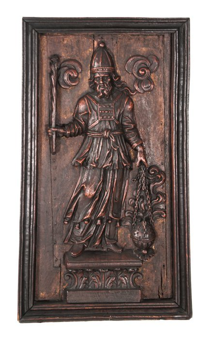 A Continental Carved Walnut Relief Depicting a Figure