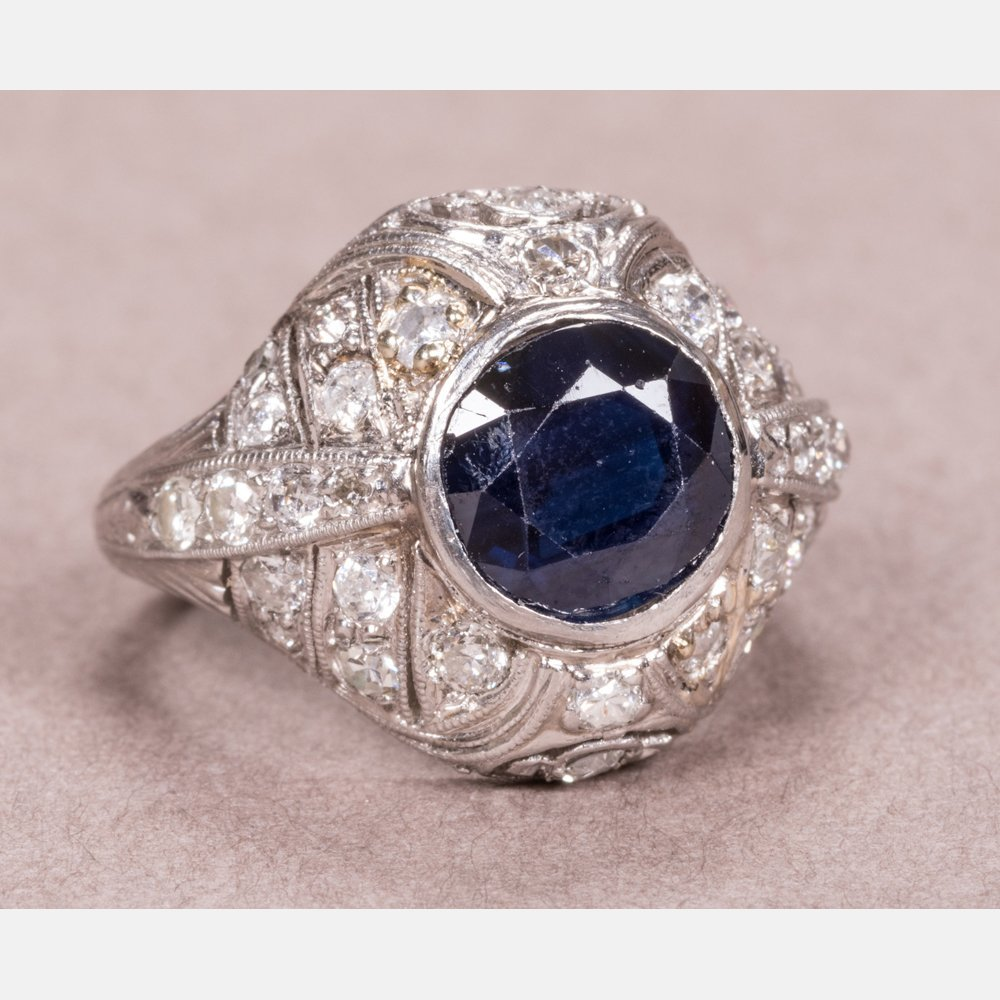A Platinum, Blue Sapphire and Diamond Ring,