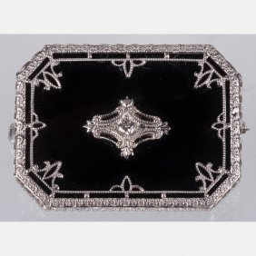 A 14kt. White Gold, Onyx And Diamond Brooch,